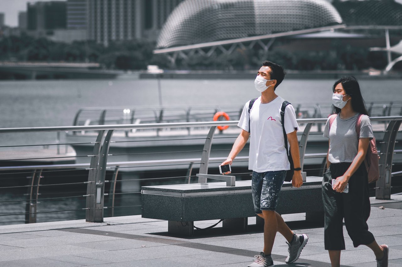 Tourists wearing masks during COVID 19 pandemic in Singapore.